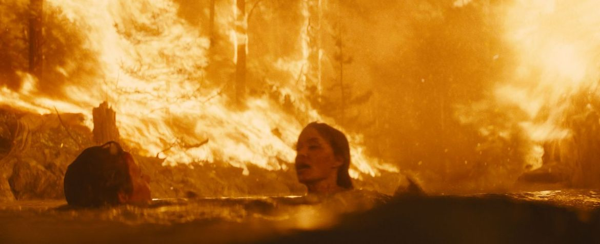 Angelina Jolie in Those Who Wish Me Dead tries to save a boy during a raging forest fire