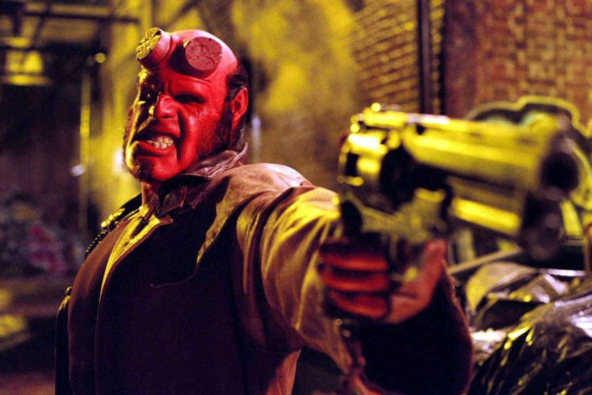 Ron Perlman, dressed in red, as Hellboy.