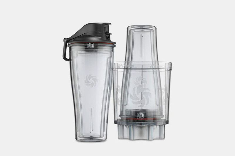 A cup secured in a Vitamix
