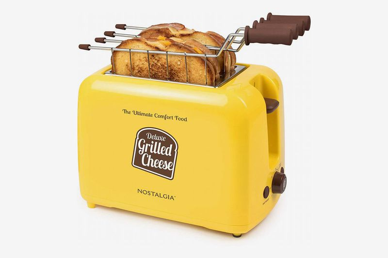 A yellow toaster with a grilled cheese sandwich