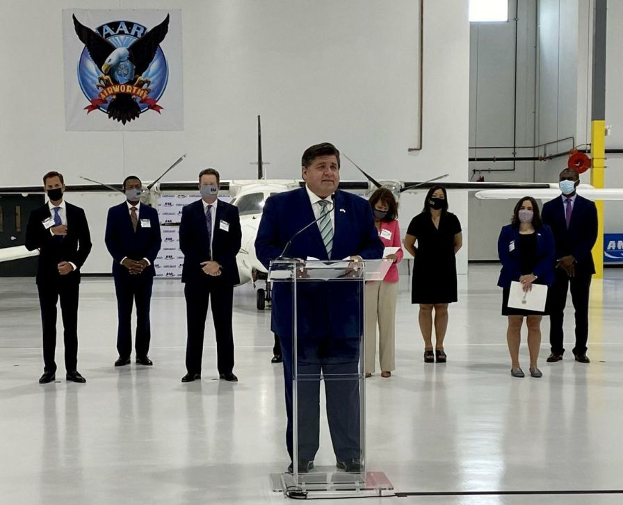 Gov.  JB Pritzker speaks at the ribbon-cutting ceremony at the Aviation Institute of Maintenance's new training center at 3711 S. Ashland on Wednesday.  & Nbsp;