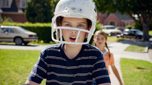 Iain Armitage in a football helmet with his mouth hanging open in Young Sheldon