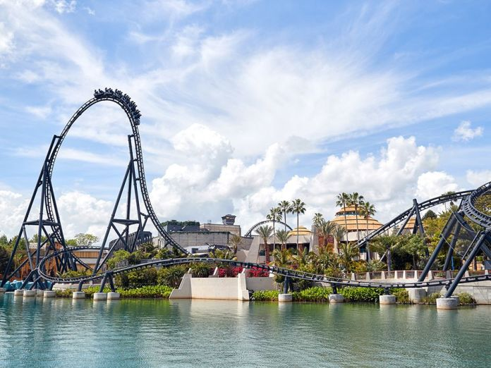 a roller coaster above a lake