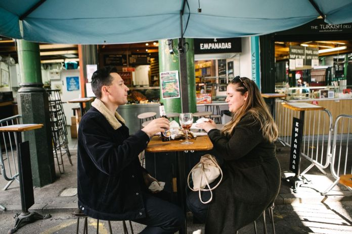 A couple having a drink at the Southwark Tavern in Borough Market