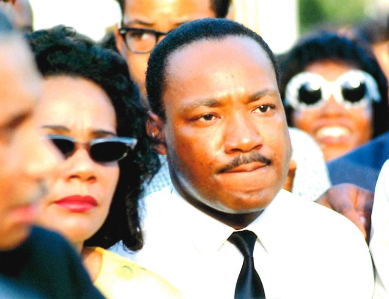 Dr. Martin Luther King, Jr. with Coretta Scott King, during a march in Marquette Park on Aug. 5, 1966. Photography by Bernard Kleina.