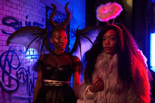 Michaela Coel and Weruche Opia in angel and devil costumes in I May Destroy You