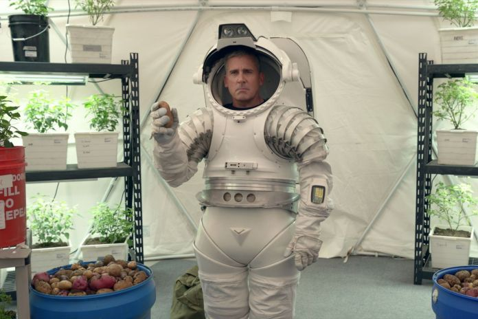 General Naird (Steve Carell) wears a space suit and holds a potato