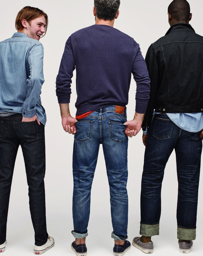 Three men wear jeans, pullovers, and denim jackets.
