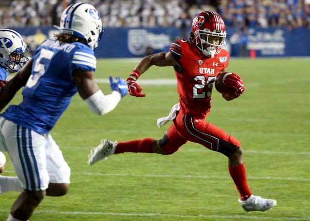 Utah Utes wide receiver Jaylen Dixon sprints to the end zone during game at BYU at LaVell Edwards Stadium