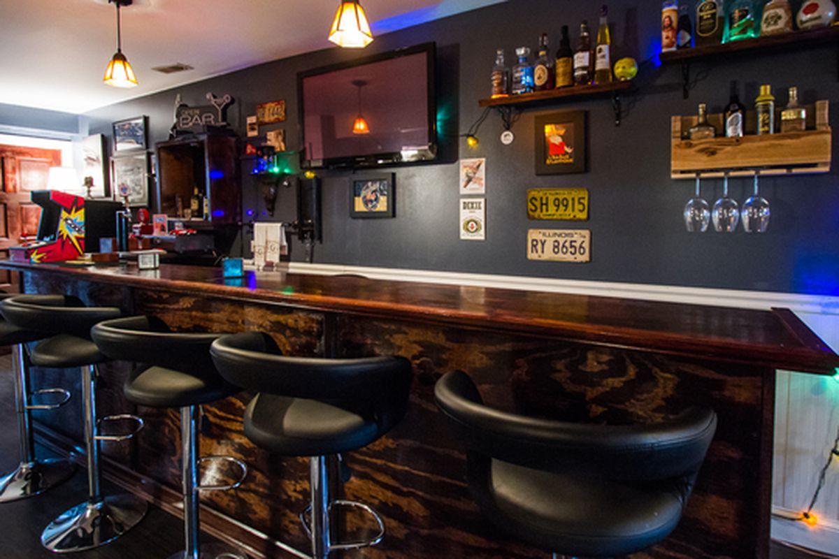 Logan Square house with serious basement bar asks 750K