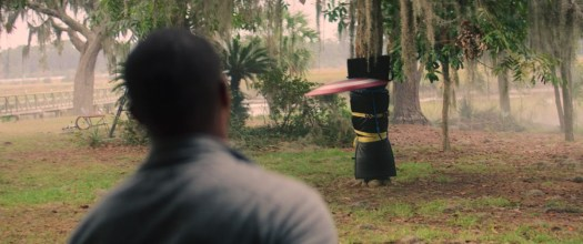 Anthony Mackie bounces the Captain America shield off a padded tree