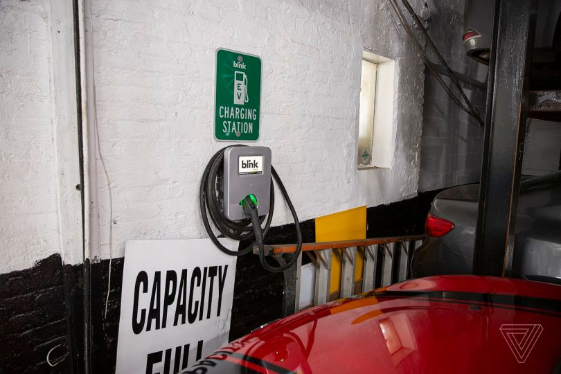 Electric vehicle charging stations in New York City are often inside paid parking lots.