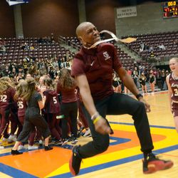 Morgan's women's basketball coach Sterling Mack literally jumps for joy after her team won the state championship on Saturday, February 27, 2021.