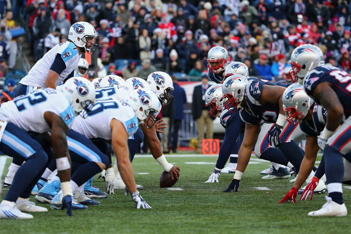 The Tennessee Titans line up opposite the New England Patriots defense