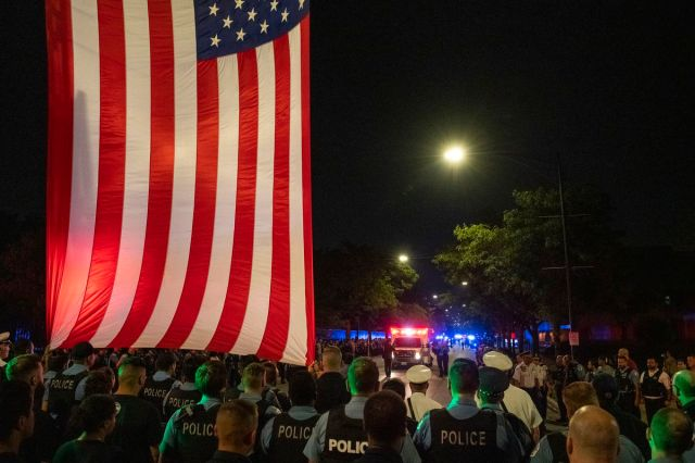 Chicago police officers gathered near the Cook County Medical Examiner's Office early on Sunday, Aug. 8, 2021 to honor the officer who was killed in the line of duty Saturday night during a traffic stop at 63rd Street and Bell Avenue.