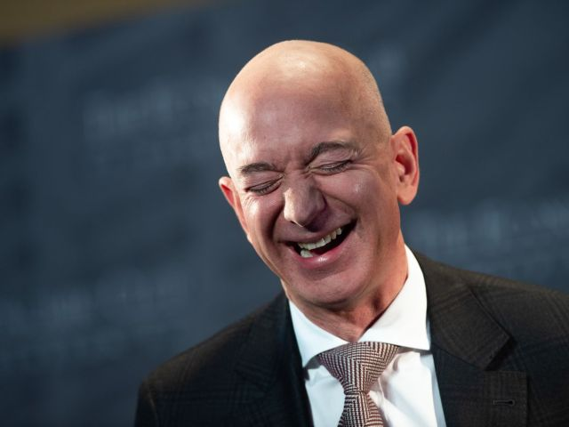 Amazon CEO Jeff Bezos smiles in a painful way.