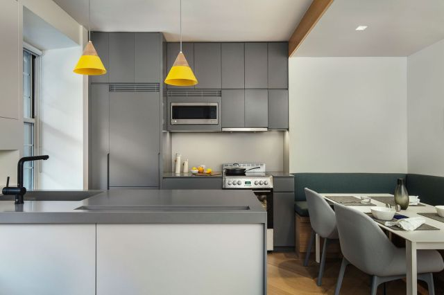 A kitchen with gray cabinets by General Assembly