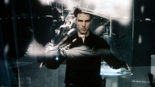 tom cruise looks at a futuristic screen