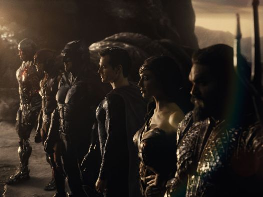 The Justice League assembled on the edge of a cliff.