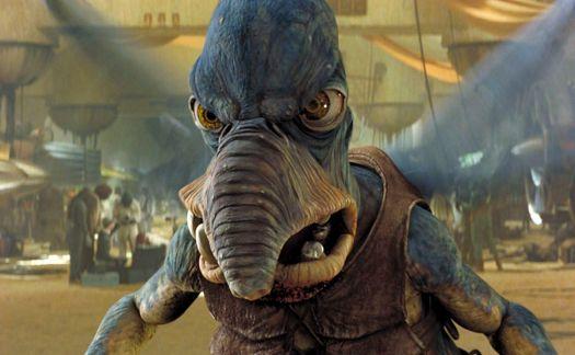 Trunk-nosed, blue-skinned, flying alien Watto seen in closeup in The Phantom Menace