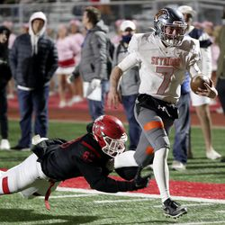 Skyridge's McCae Hillstead runs past American Fork's Hunter Clegg and scores a touchdown during a varsity football game at American Fork High School in American Fork on Wednesday, Oct. 13, 2021.