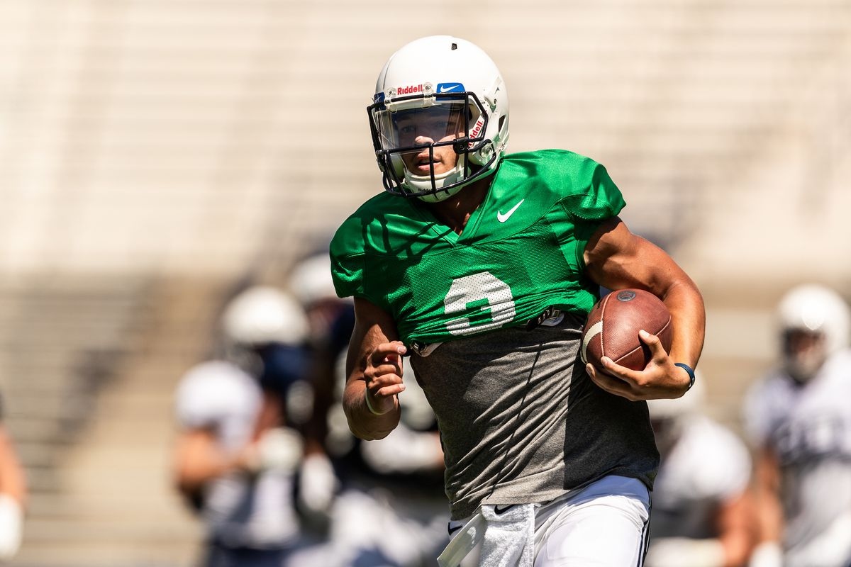 BYU quarterback Jaren Hall runs with the ball during the Cougars' scrimmage at LaVell Edwards Stadium on Saturday, Aug. 10, 2019.
