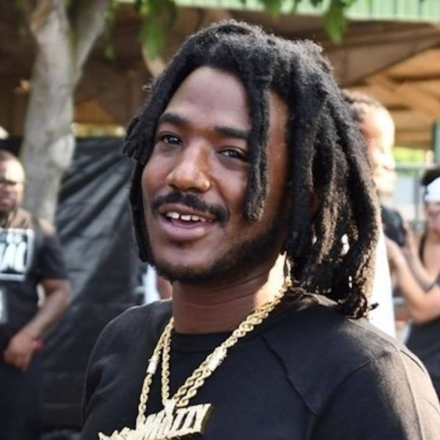 Mozzy makes a young fan's day by letting him hop in his Lamborghini - REVOLT