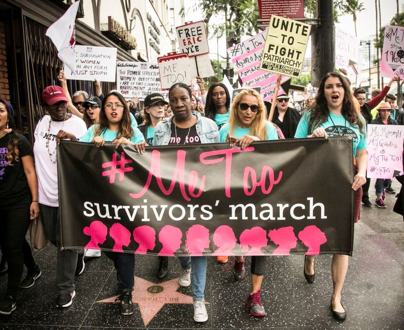 """Brenda Gutierrez (third from left) and Tarana Burke (center) lead the """"Take Back The Workplace March"""" and """"#MeToo Survivors March & Rally"""" on November 12, 2017, in Beverly Hills, California"""