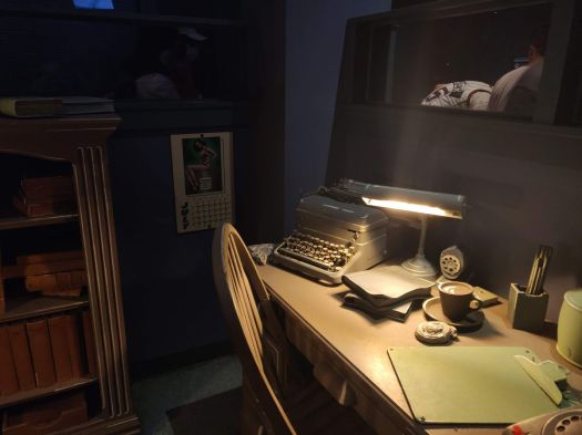 a desk with a typewriter