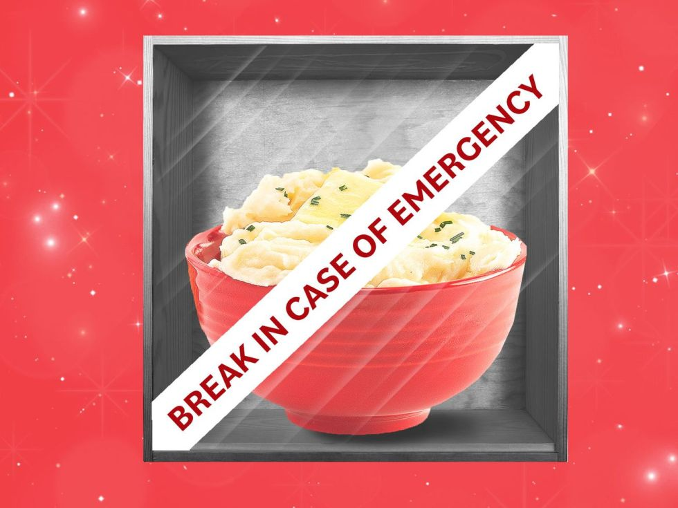 "Bowl of mashed potatoes behind glass in a case that reads ""Break in case of emergency."""