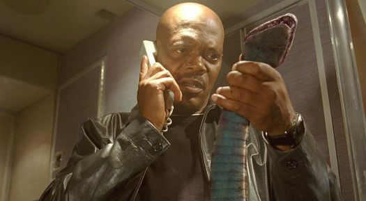 Samuel L. Jackson holds up a dead motherfucking snake on his motherfucking plane and looks disgusted.