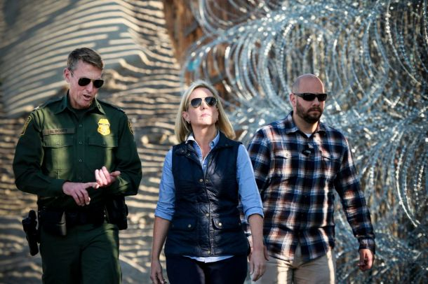 Kirstjen M. Nielsen, Secretary of the Department of Homeland Security, tours the border area with San Diego Section Border Patrol Chief Rodney Scott (L) at Borderfield State Park along the United States-Mexico Border fence in San Ysidro, California on Nov
