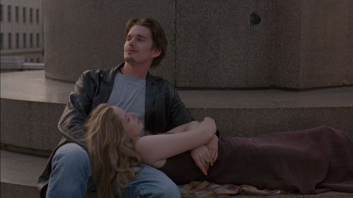 Julie Delpy leans her head in Ethan Hawke's lap