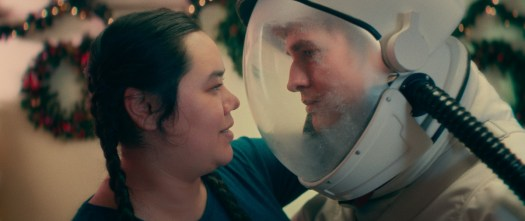 janet and a boy in an astronaut helmet