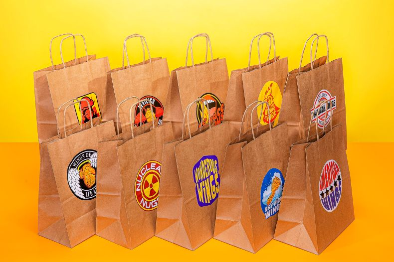 An image of ten bags in two rows of five, each with a different made up chicken wing restaurant logo, against a yellow backdrop.