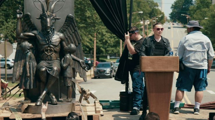 Lucien Greaves, spokesman and co-founder of the Satanic Temple, with the statue of Baphomet.