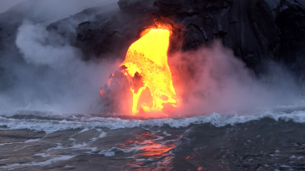 hight resolution of lava from kilauea volcano flowing into the ocean creating new land