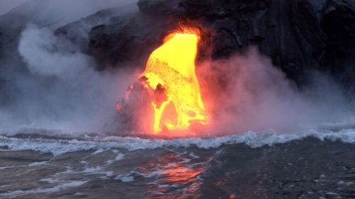 small resolution of lava from kilauea volcano flowing into the ocean creating new land