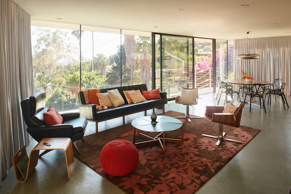 how much to carpet a living room photos of curtains in rooms rug ideas and tips choose the right one curbed at concrete ciffside home la an area plays up space s accent colors while adhering trick putting front legs side chairs on