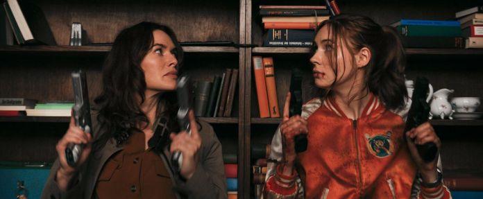 GUNPOWDER MILKSHAKE (L-R): LENA HEADEY as SCARLET, KAREN GILLAN as SAM.