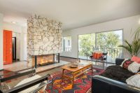 Modern Eagle Rock midcentury with statement fireplace asks