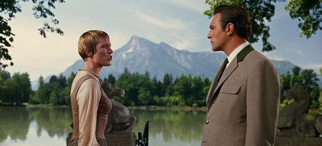 Maria (Julie Andrews) and Captain Von Trapp (Christopher Plummer) argue in the garden in a screenshot from The Sound of Music