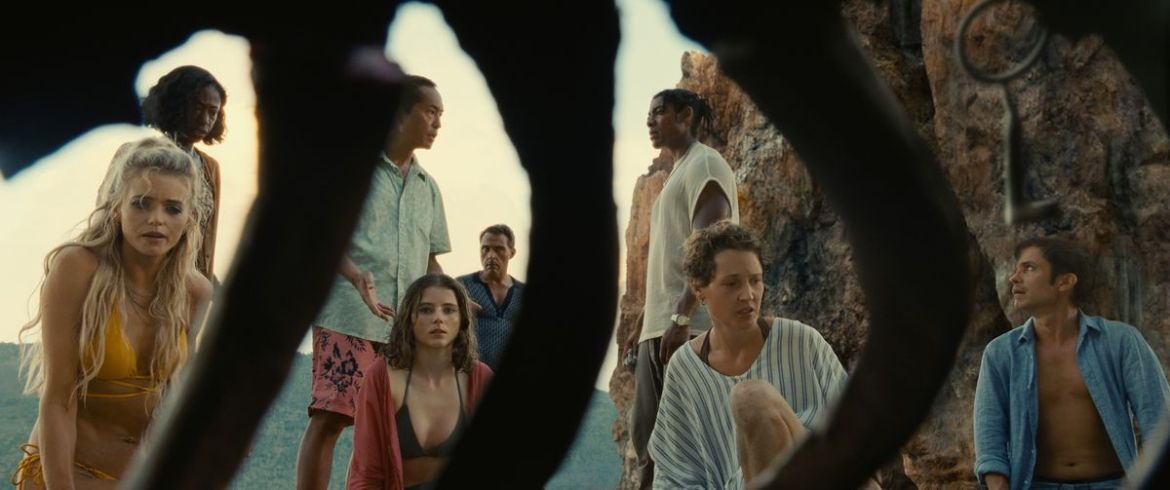 Beachgoers discover a skeleton in M. Night Shyamalan's Old.