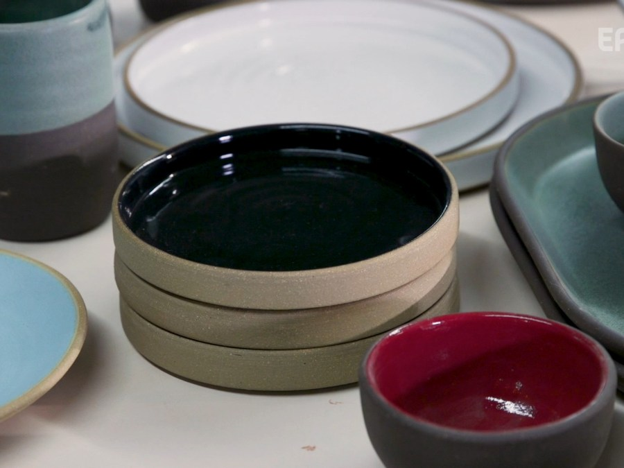 An array of ceramic plates and mugs