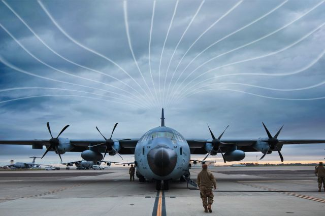 """Air Force C130 plane on tarmac, with illustrated """"atmospheric river"""" lines in the sky"""