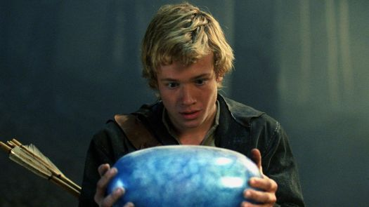 a blonde young man holding a blue dragon egg