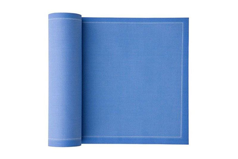 Unrolling a roll of royal blue cocktail napkins