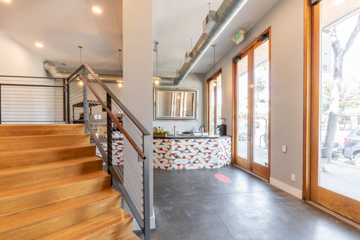Brown stairs to an upper loft area
