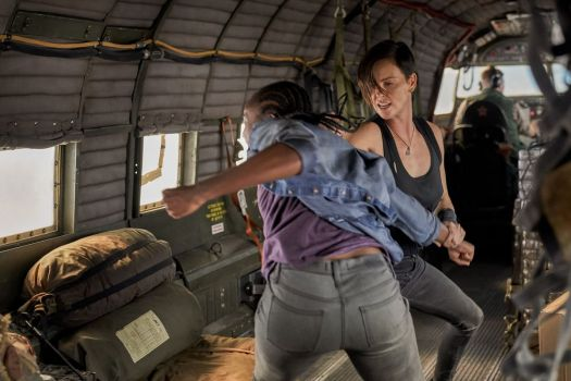 Charlize Theron and KiKi Layne punch the crap out of each other in a plane in The Old Guard.