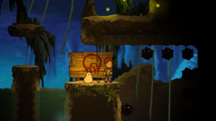 In this screenshot of A Boy And His Blob (2009), the two titular characters stand on a platform together, ready to explore.